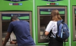 Customers use Lloyds ATMs