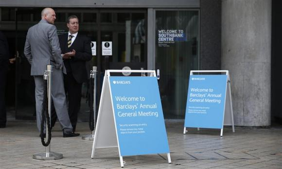 Signs welcome shareholders to the Barclays' AGM in central London